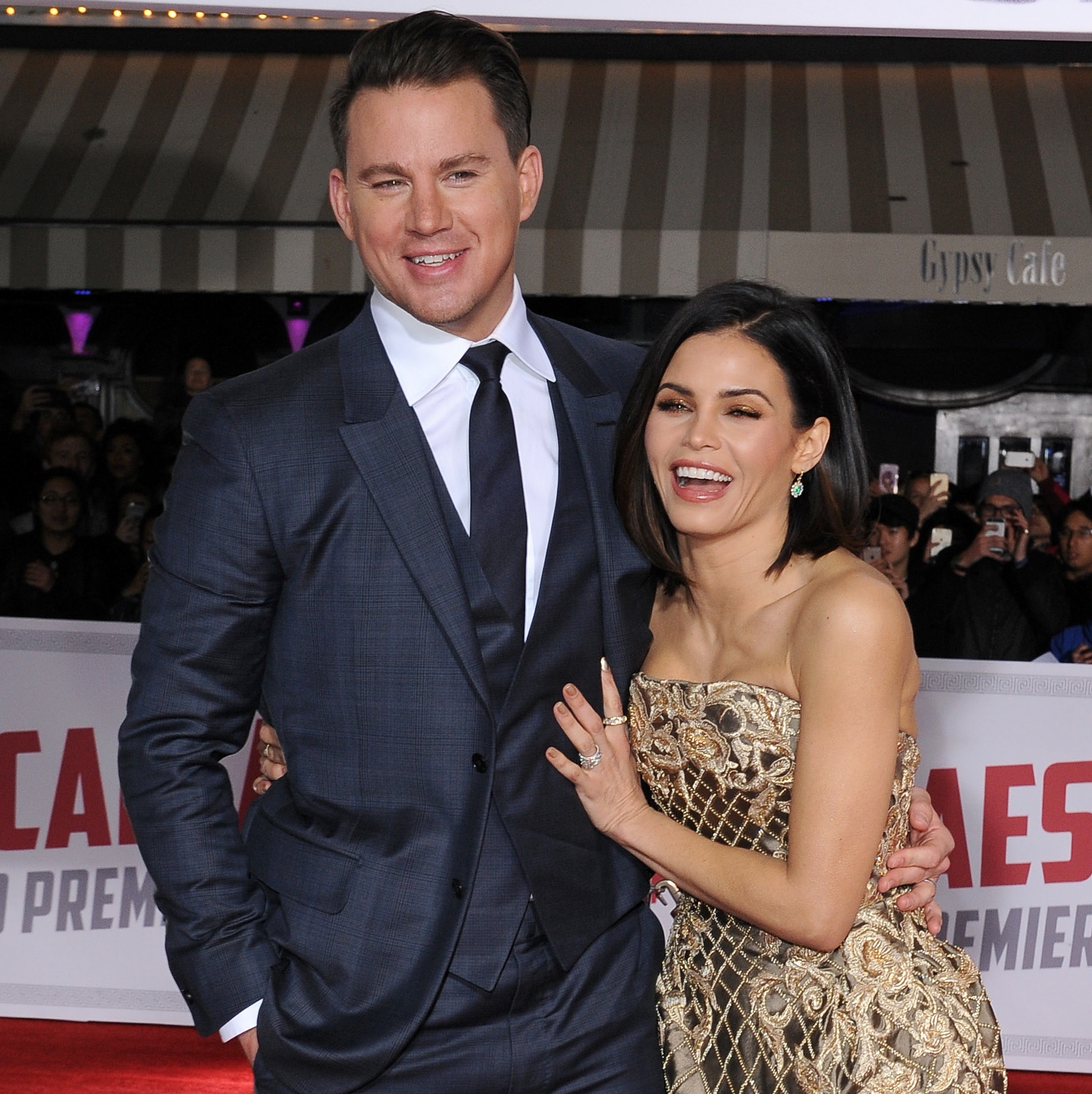 Channing Tatum and Jenna Dewan laughing at a movie premiere.