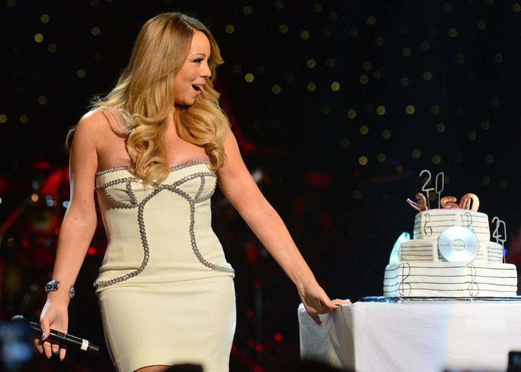Mariah Carey with a cake