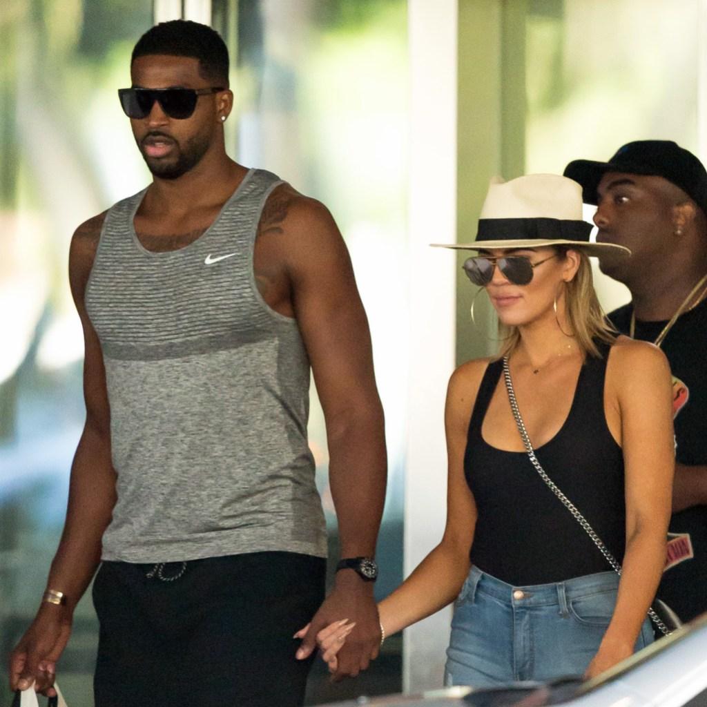 Tristan Thompson and Khloe Kardashian holding hands