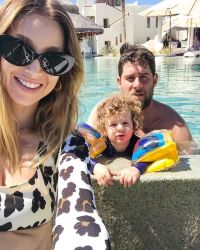 Whitney Port Takes Selfie as Husband Tim Rosenman and Son Sonny Play in Pool Behind Her