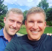 kyle and todd chrisley pose for selfie