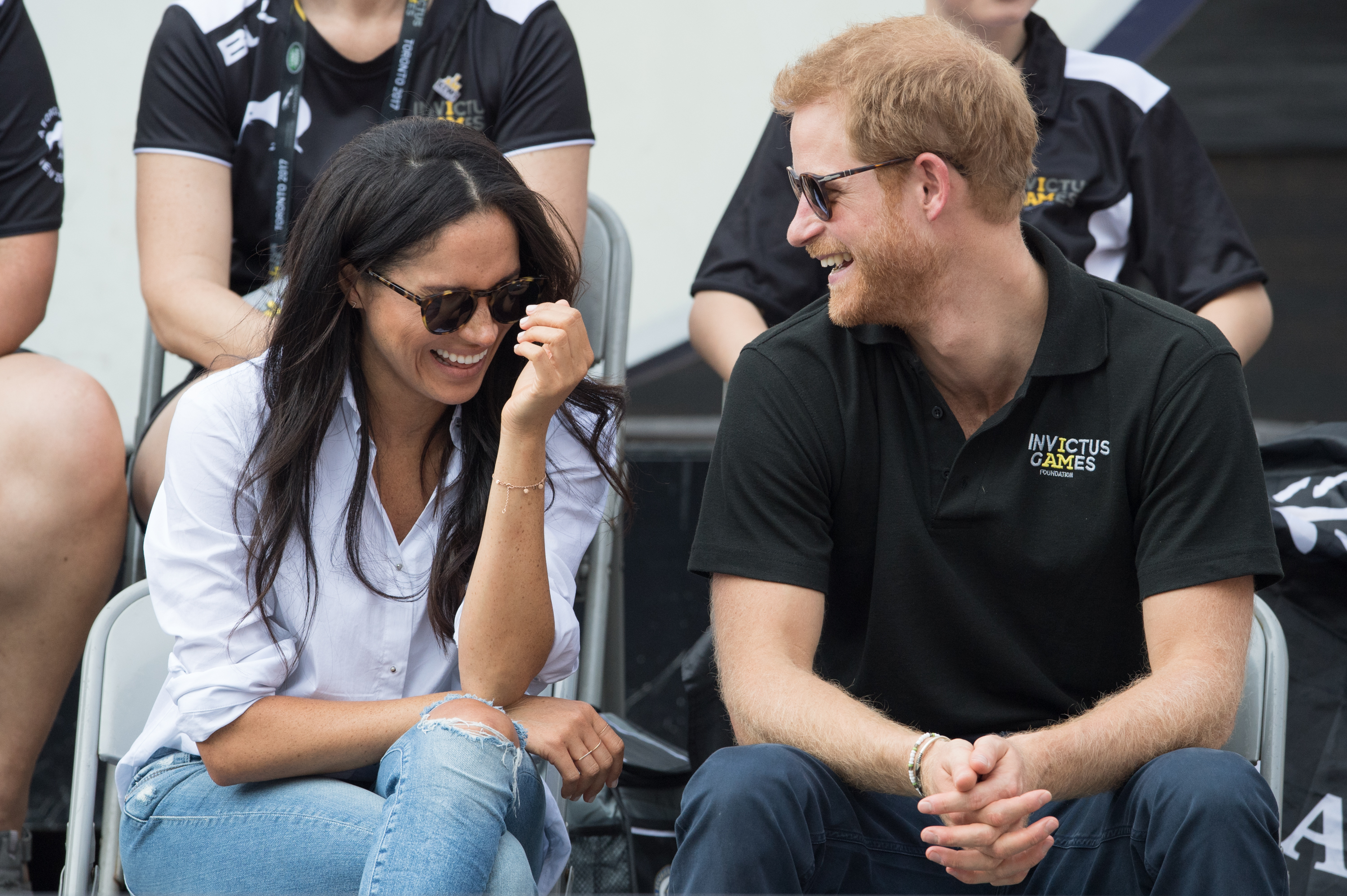 Meghan Markle and Prince Harry smiling.