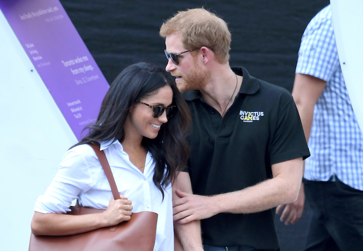 Meghan Markle and Prince Harry showing some PDA.