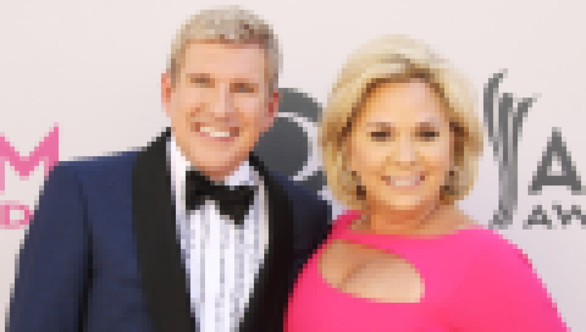 Todd Chrisley Wears Blue Tux With Wife Julie in Pink Dress