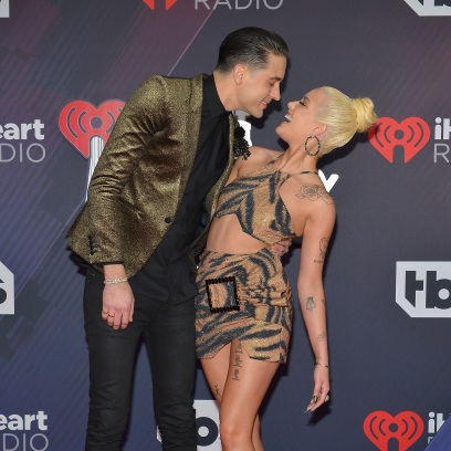 G-Eazy and Halsey show some PDA on a red carpet.