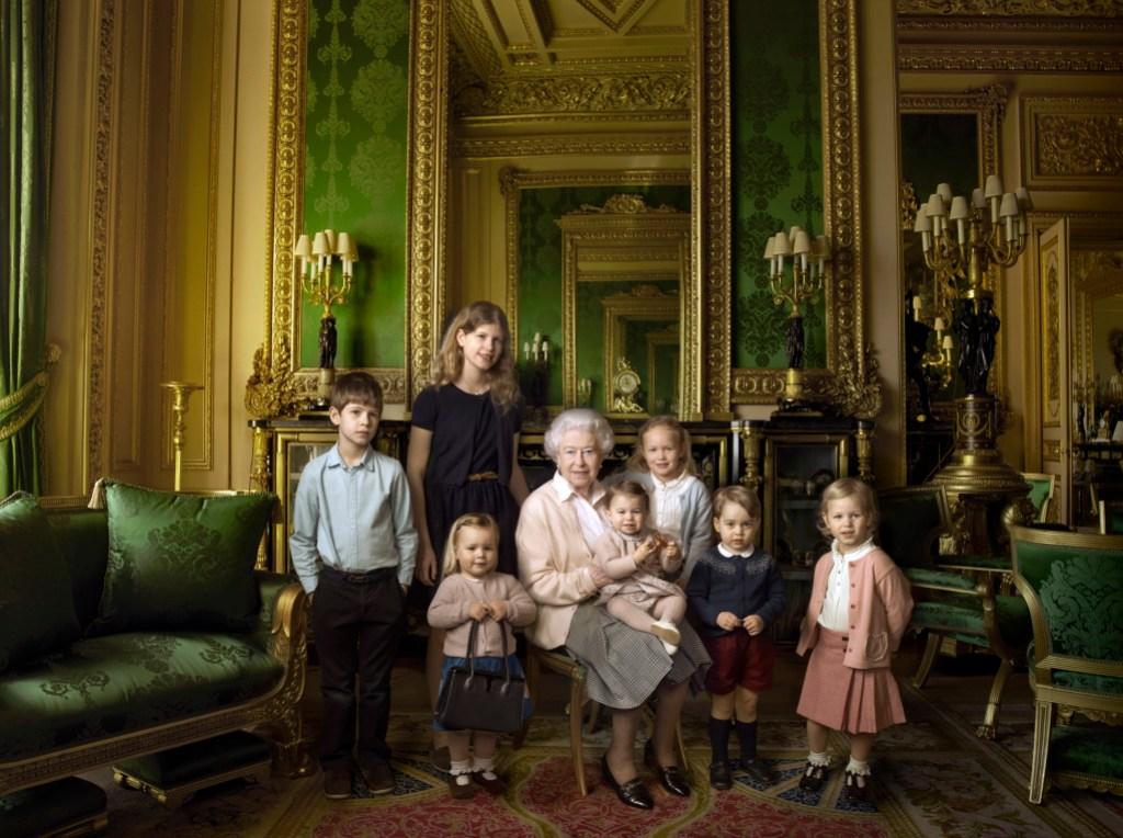 Queen Elizabeth posing with her great-grandchildren