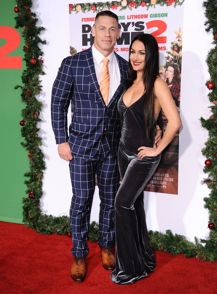 """John Cena and Nikki Bella attend the premiere of """"Daddy's Home 2"""" at Regency Village Theatre on November 5, 2017 in Westwood, California."""