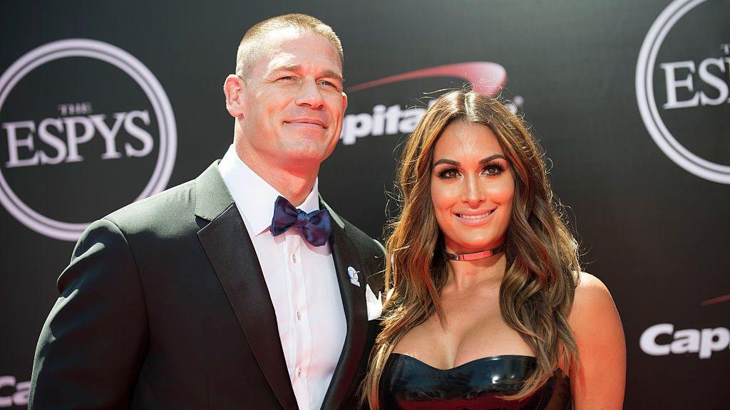 John Cena and Nikki Bella posing at the ESPY awards wearing black outfits