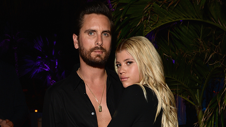Scott Disick and Sofia Richie showing some PDA at an event.
