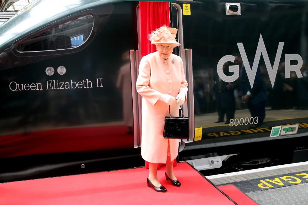 Queen Elizabeth, Standing By A Train