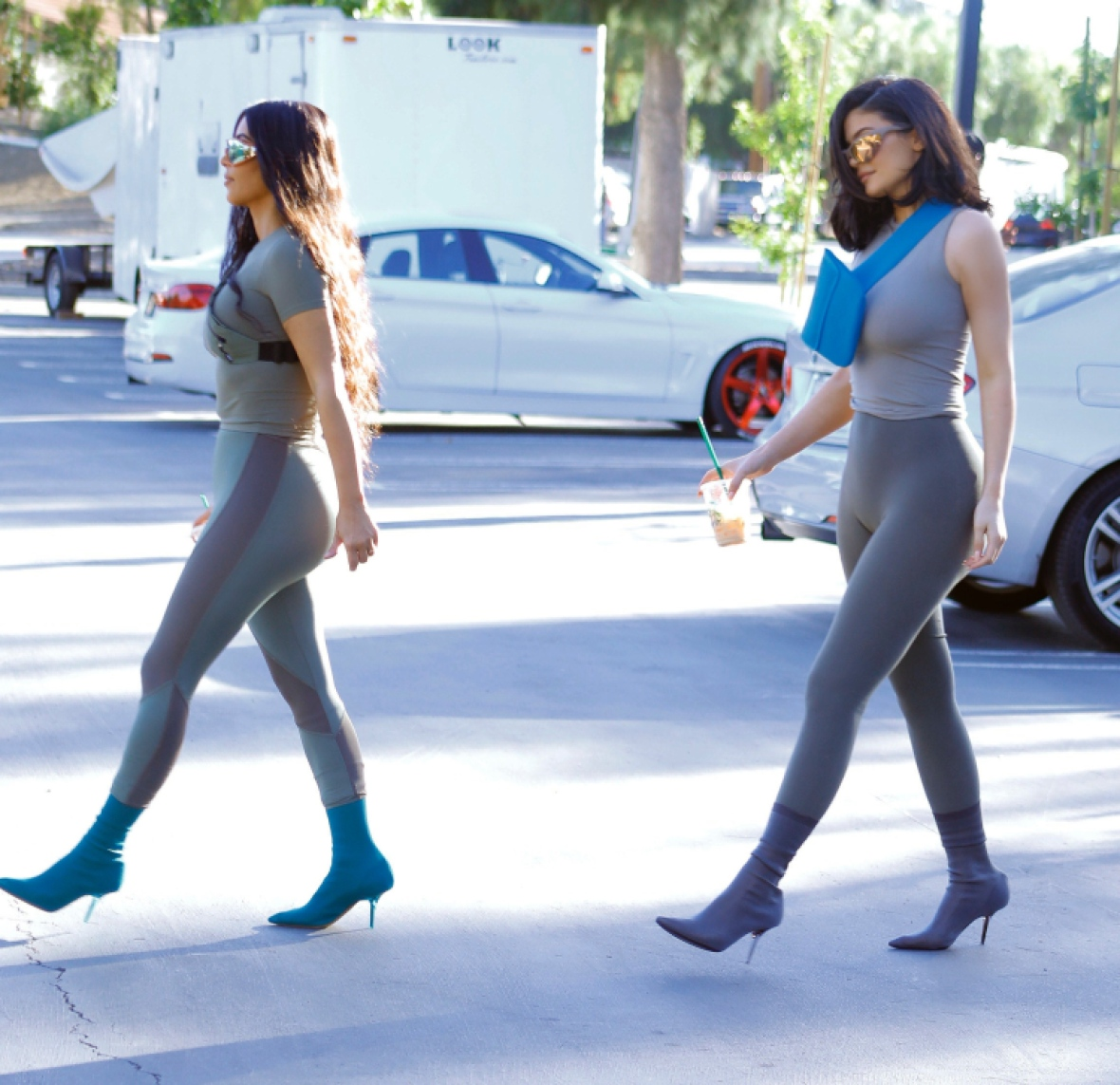 https://www.lifeandstylemag.com/wp-content/uploads/2018/07/kim-kardashian-kylie-jenner-matching-outfits.jpg?w=750&crop=1&resize=1180%2C1143