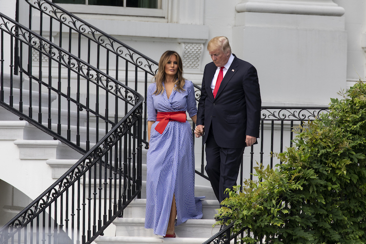 melania and donald trump holding hands