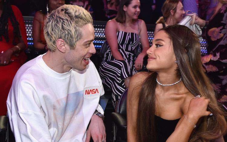Ariana Grande smiling at Pete Davidson