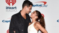 Wells Adams and Sarah Hyland being lovey at iHeart Radio carpet.