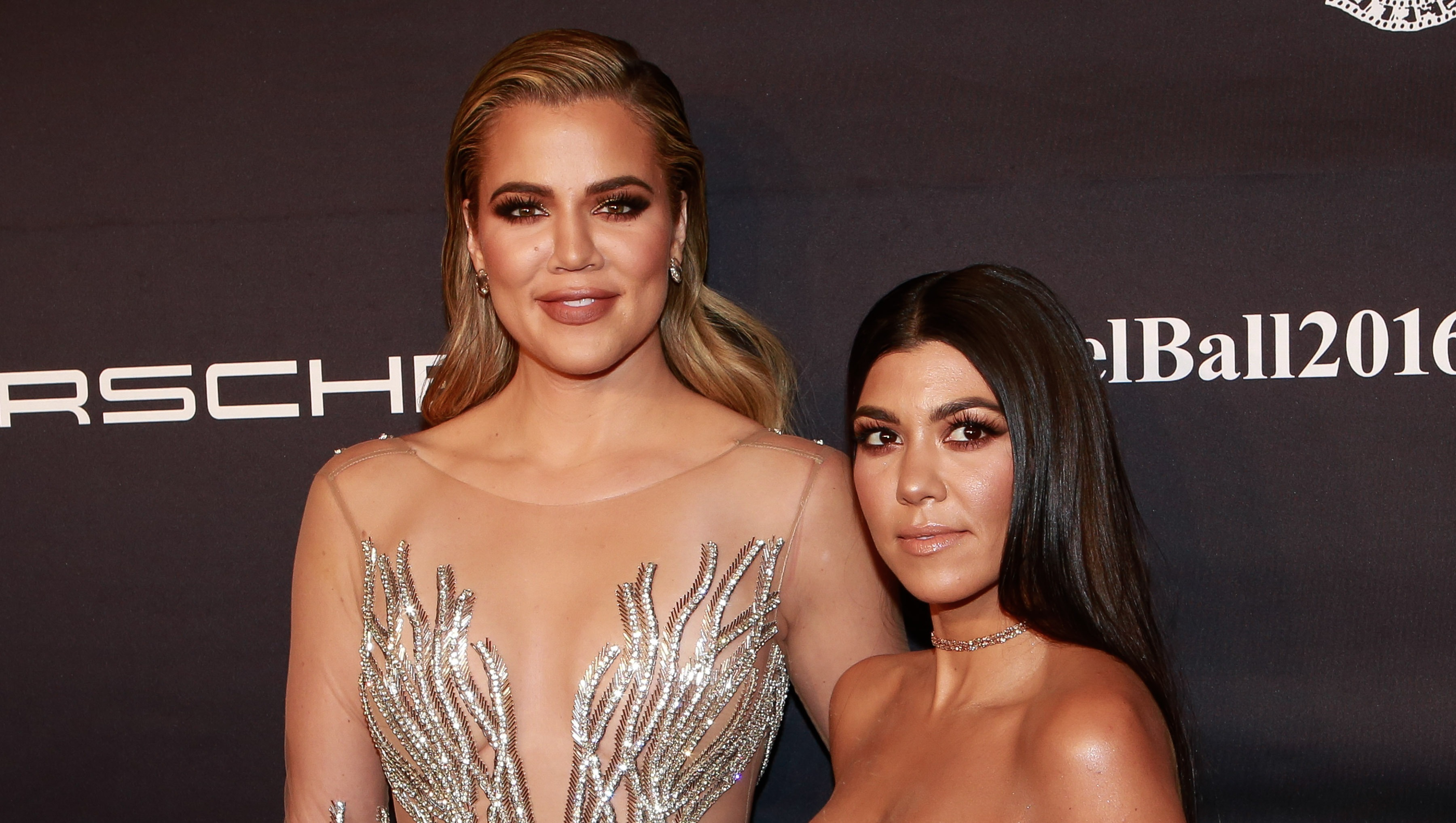 Khloe and Kourtney Kardashian posing