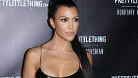 Kourtney Kardashian posing
