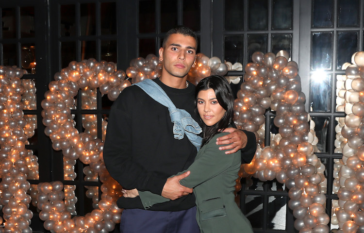 Kourtney Kardashian and Younes Bendjima at a party together.