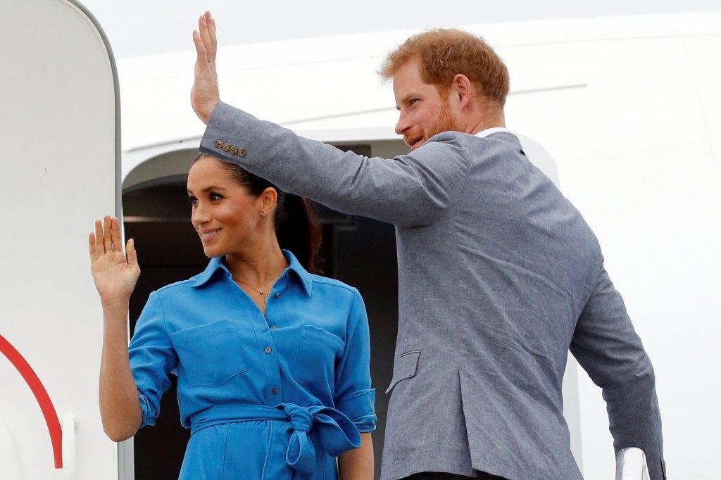 prince Harry and Meghan Markle waving