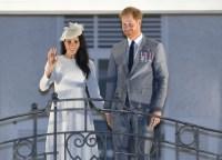 Meghan Markle and Prince Harry waving