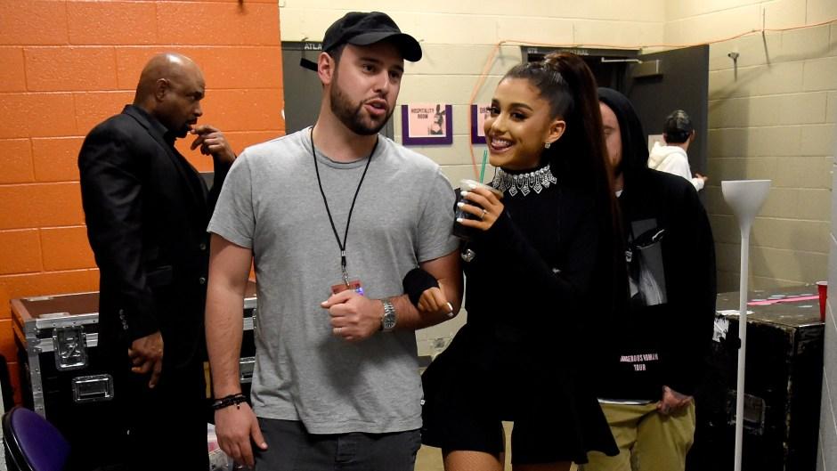 Ariana Grande and Scooter Braun walking