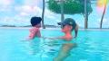 Khloe Kardashian and True Thompson in the pool