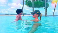 Khloe Kardashian and True Thompson in the pool