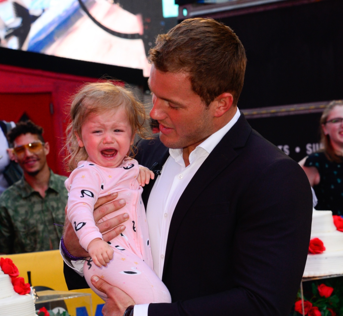 colton underwood holds a crying emmy tolbert