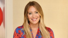 Hilary Duff wearing red and blue dress