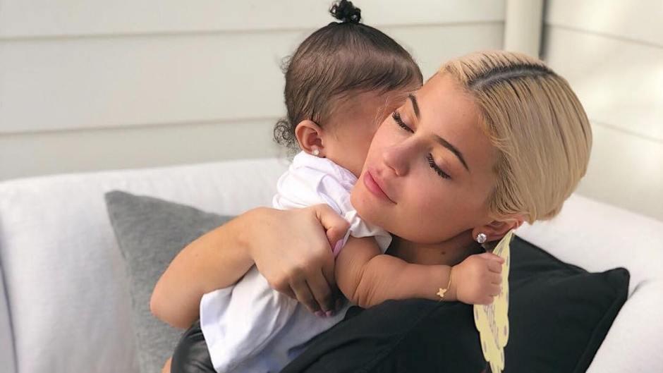 Kylie Jenner holding her daughter Stormi Webster