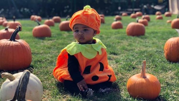 True Thompson wearing a pumpkin Halloween costume