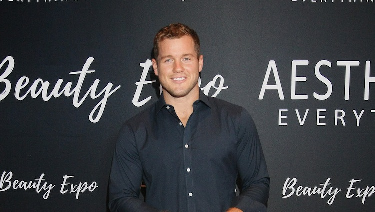 The Bachelor Colton Underwood stands on red carpet smiling