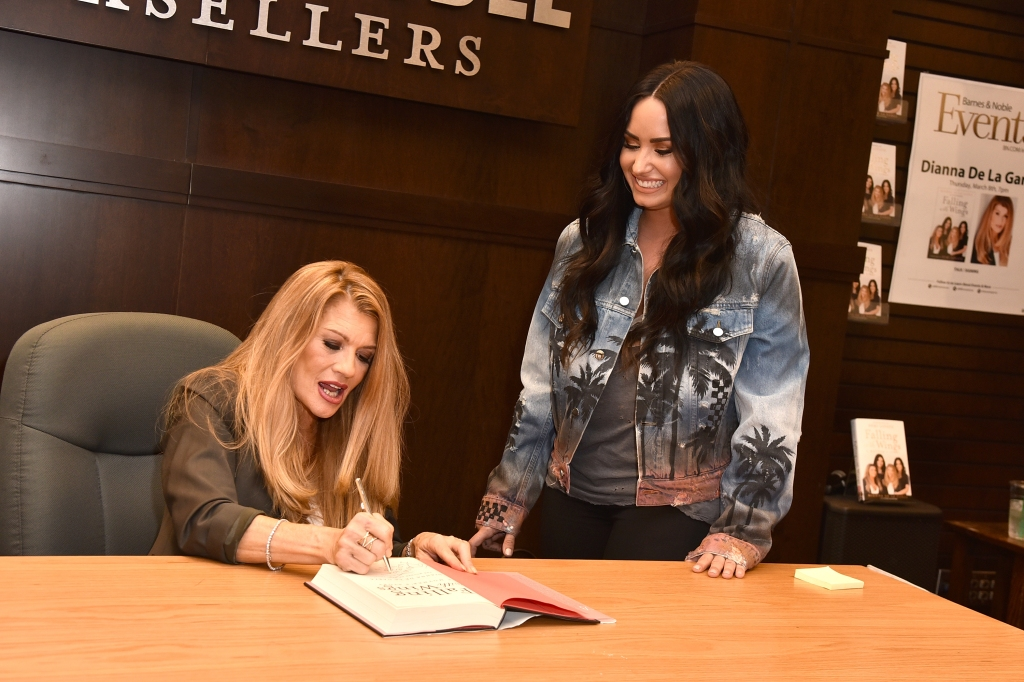 Demi and her mom at a book signing