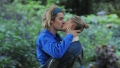 Justin Bieber and Hailey Baldwin kissing in London, Justin wearing a blue shirt and headband