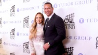 Jennifer Lopez and Alex Rodriguez at an event in NYC, J.Lo wearing a white dress and A-Rod wearing a suit