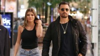 Scott Disick and Sofia Richie out together in Australia. Sofia wearing a black tank top and jeans