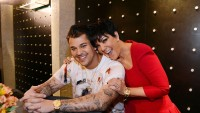 Rob Kardashian with his mom Kris Jenner, she is wearing a red shirt