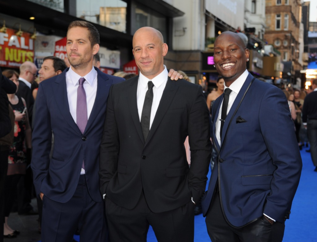 Paul Walker, Tyrese Gibson, and Vin Diesel at the premiere together all wearing suits