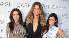 Kim Kardashian, Khloe Kardashian, and Kourtney Kardashian at an event. Kim wearing sequin dress, Khloe wearing black dress, and Kourtney wearing white and blue dress