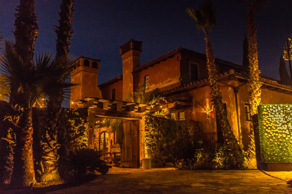 The Bachelor Mansion shot from the outside at night