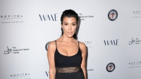Kourtney Kardashian wearing black at an event