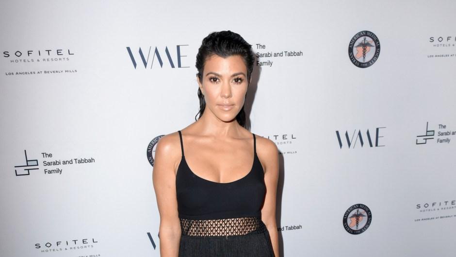 Kourtney Kardashian wearing black at an event