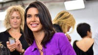Kendall Jenner in purple dress smiling