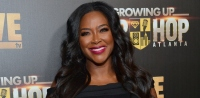 Kenya Moore pregnant on the red carpet