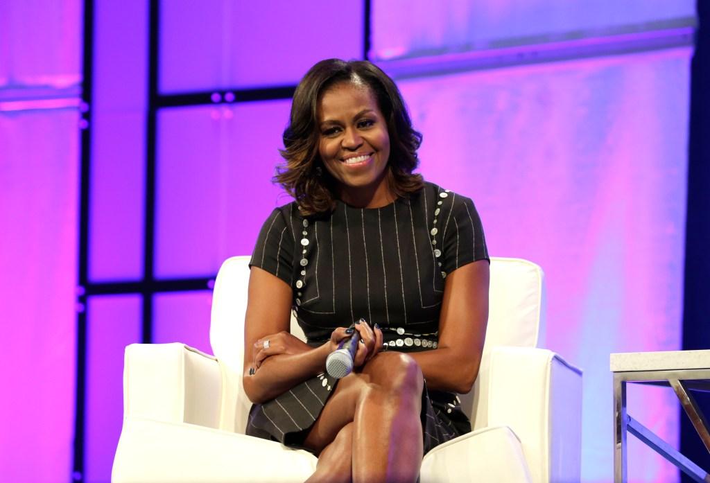 Michelle Obama sitting