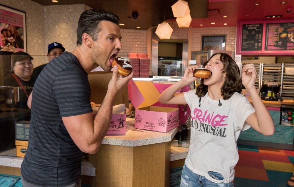 Millie Bobby Brown eating donut