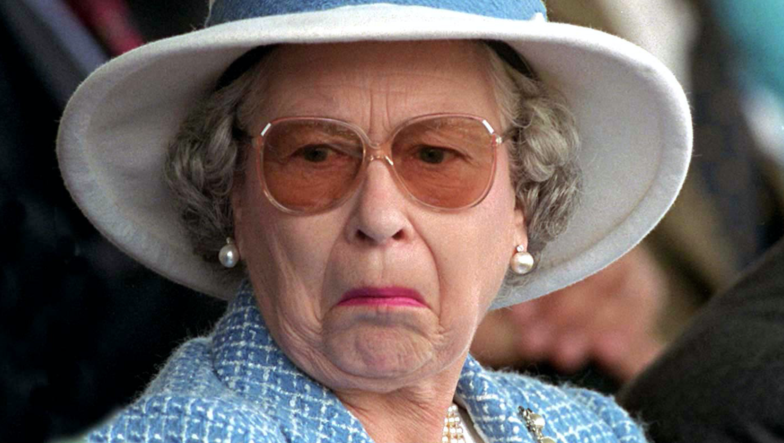 Queen-Elizabeth-Unamused-Face-White-Hat-Glasses