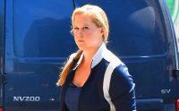 Amy Schumer Walking In Front Of Blue Van