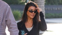 kourtney kardashian shuts down pregnancy rumors