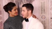 Nick Jonas and Priyanka Chopra giving each other a lovey look at an event