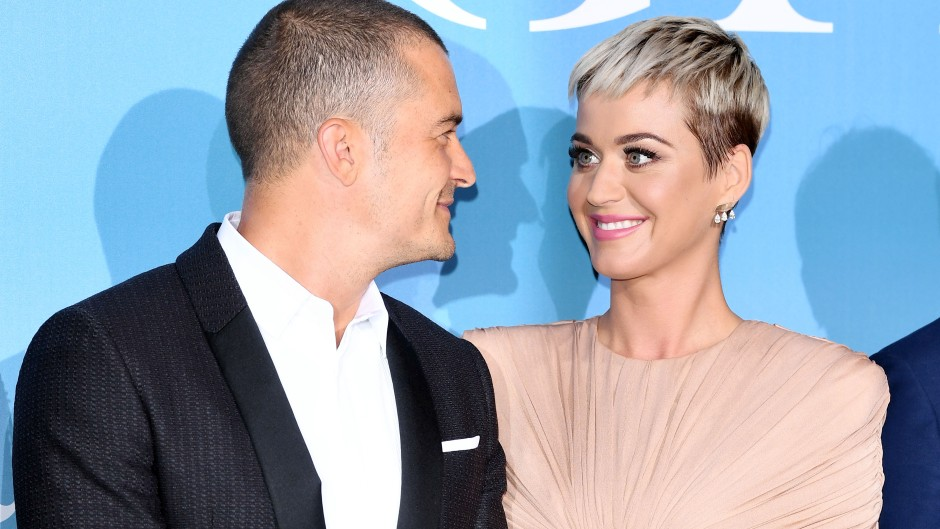 Katie Perry, Orlando Bloom, Smiling at each other, red carpet event